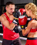 Couple Man and Woman Boxing in Ring. Royalty Free Stock Image