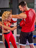 Couple Man and Woman Boxing in Ring. Royalty Free Stock Photography