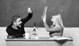 Couple of man and woman in classroom. Student life. Lesson and blackboard. Teachers day. Modern school. Knowledge day royalty free stock photography