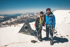 Couple Man and Woman climbing reached Elbrus mountain royalty free stock photos