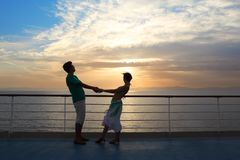 Couple: man with woman on deck of cruise ship. Sunset Stock Photography
