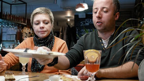 Couple man woman eats talks and tries a new dish Stock Photo