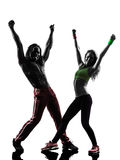 Couple man and woman exercising fitness zumba dancing silhouette Stock Photo