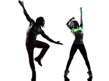 Couple man and woman exercising fitness zumba dancing silhouette. Couple men and women exercising fitness zumba dancing in silhouette on white background Royalty Free Stock Photo