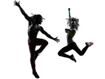 Couple man and woman exercising fitness zumba dancing silhouette Stock Image