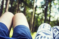 Couple Man and Woman Feet in Love Romantic Outdoor with Autumn season nature on background Fashion trendy style. A guy and a girl Royalty Free Stock Photo