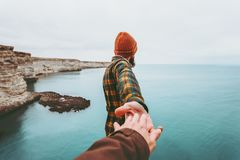 Couple Man and Woman holding hands follow stock image