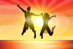 Couple man and woman holding hands jump silhouette Royalty Free Stock Images