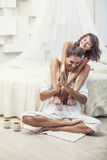 Couple man and woman at home in bed with a book and hot drink Royalty Free Stock Photos