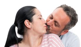 Man and woman kissing and hugging. Couple men and women kissing lips and hugging isolated on white studio background royalty free stock photo