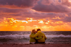 Couple Man and Woman in Love kissing and hugging o. N Beach seaside with Beautiful Sunset sky scenery People Romantic relationship concept Stock Image