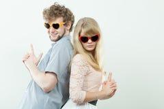 Couple man and woman making gun gesture. Stock Photo