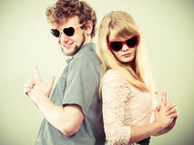 Couple man and woman making gun gesture. Stock Photography