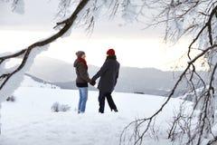 Couple Man Woman mountain winter snow fun Royalty Free Stock Photo