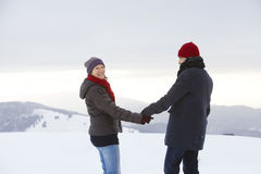Couple Man Woman mountain winter snow laugh Stock Photos