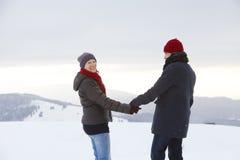 Couple Man Woman mountain winter snow laugh Royalty Free Stock Photos