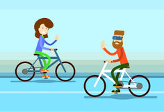 Couple Man Woman Ride Towards Bicycle Wave Hand Greeting Royalty Free Stock Images