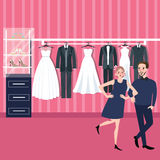 Couple man woman select wedding dress in bridal store Royalty Free Stock Photos