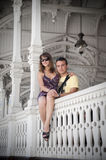 Couple man and woman she is sitting on the railing Royalty Free Stock Photography