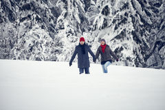 Couple Man Woman snow forest walk Royalty Free Stock Photography