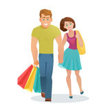 Couple man and woman walking with shopping bags Stock Photography