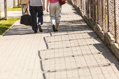 Couple man and woman walking with sport bags. Couple men and women with sport gym bags walking outdoor. Active young girl and guy in training suit sportswear Stock Images