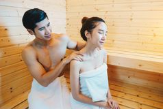Couple, man and woman were sitting and drinking wine in the sauna Stock Photo
