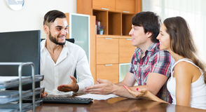 Couple and manager talking about purchase in the office Royalty Free Stock Photography