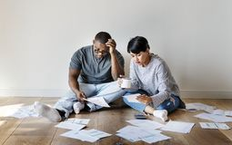 Couple managing the debt together Stock Photos