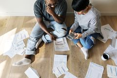 Couple managing the debt together Stock Images