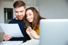 Couple managing their bills at home Stock Images