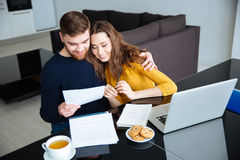 Couple managing their bills at home Royalty Free Stock Photography