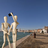 Couple of manikins shots a selfie in Venice Royalty Free Stock Photos