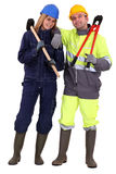 Couple of manual workers Royalty Free Stock Images