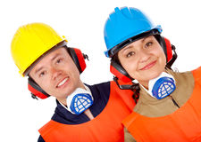 Couple of manual workers Stock Images