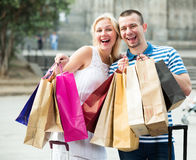 Couple with many bags outdoors Royalty Free Stock Photos