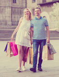 Couple with many bags outdoors Royalty Free Stock Photo