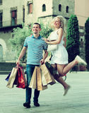 Couple with many bags outdoors Royalty Free Stock Images