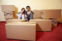 Couple between many moving boxes Royalty Free Stock Image