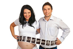 Couple with many sonogram images Royalty Free Stock Photography