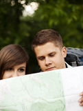 Couple with map. Hiking collection: couple looking at map Stock Photos