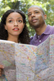 Couple with a map Royalty Free Stock Photos