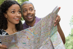 Couple with a map Royalty Free Stock Photo