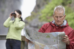 Couple With Map And Binoculars Royalty Free Stock Image