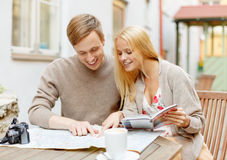 Couple with map, camera, city guide and coffee Stock Photo