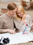 Couple with map, camera and travellers guide Stock Photography