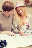 Couple with map, camera and travellers guide Royalty Free Stock Photo