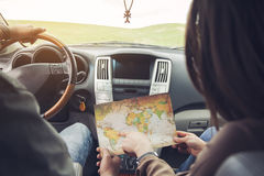 Couple and map in car. Happy couple driving in car with map Royalty Free Stock Image