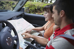 Couple With Map In Car Royalty Free Stock Photo