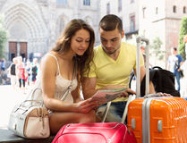 Couple with map on city streets Stock Image